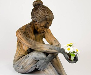 The wood-like ceramic sculptures by C. D. White