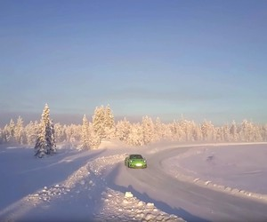 A Porsche GT3 RS races through the snow of Finland